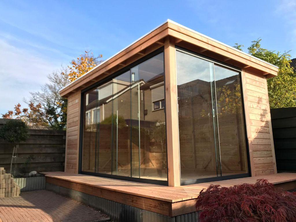 Veranda platdak + glazen schuifpanelen Zevenaar